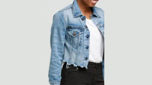 A woman in a denim jacket